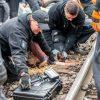 Endegelände 28.10.2018: ueber tausend AktivistInnen verlassen nach fast 24 stuendiger Sitzblockade die Schienen der Hambachbahn. Einige gehen nicht freiwillig und werden von der Polizei geraeumt. Eizelne AktivistInnen sind mit Lock-Ons an die Gleise geke:    Array